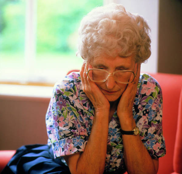 Senior Photograph - Loneliness: Elderly Woman Clasping Face In Hands by Sheila Terry/science Photo Library