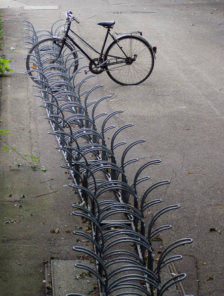 Bicycle Rack Photograph - Lonely Bike At Bicycle Rack by Matthias Hauser