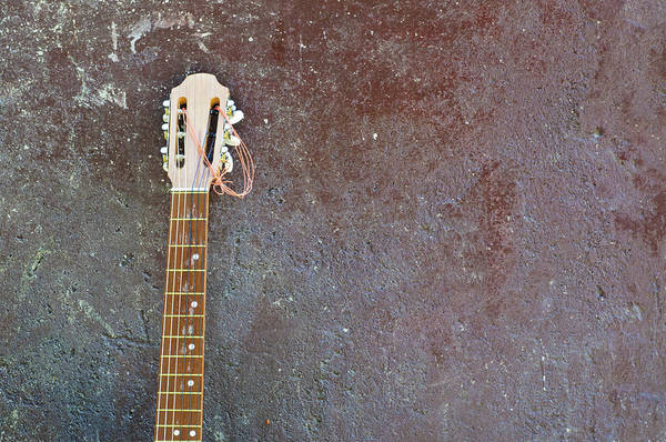 Spanish Guitar Wall Art - Photograph - Lonesome Guitar Leaning On Wall by Mac99