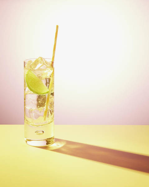 Drinking Glass Photograph - Long Drink In Glass With Lime And Straw by Felicity Mccabe
