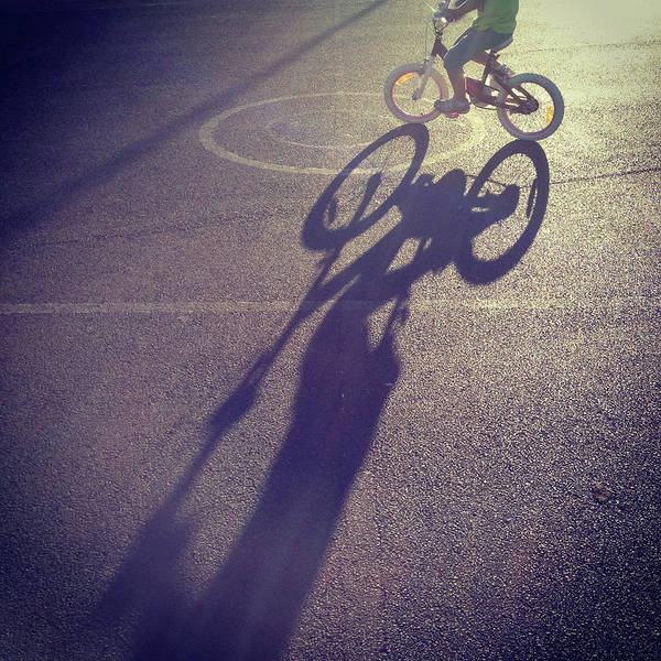Shadow Photograph - Long Shadow Of Child Riding A Bicycle by Jodie Griggs