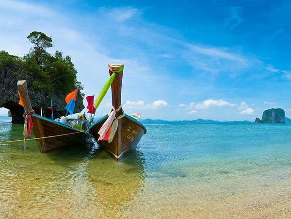 Photograph - Long Tail Boats by U Schade