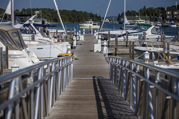 Charlevoix Photograph - Looking Down The Dock by John McGraw
