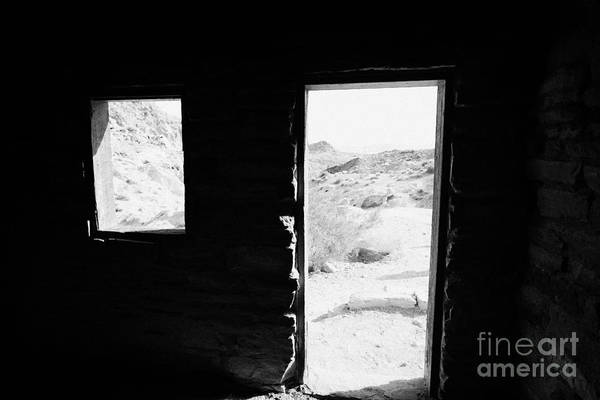 Civilian Conservation Corps Wall Art - Photograph - Looking Out Through Window And Door  From Interior Of Historic Stone Cabin Built By The Civilian Con by Joe Fox