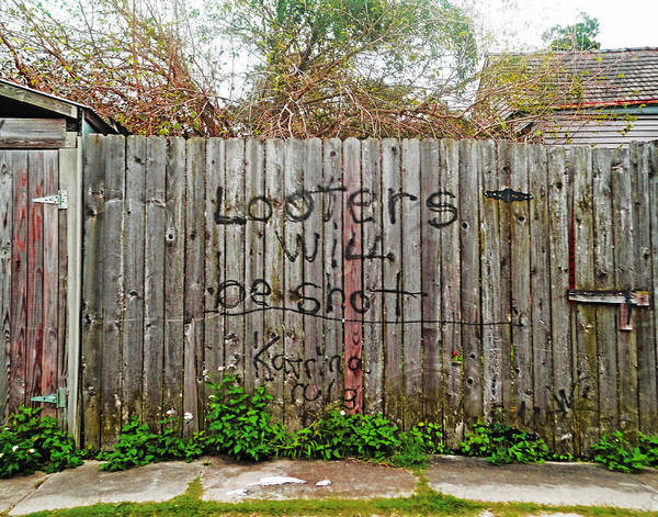 Photograph - Looters Will Be Shot Fence In New Orleans by Louis Maistros