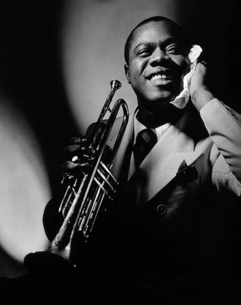 Celebrities Photograph - Louis Armstrong Holding A Trumpet by Anton Bruehl