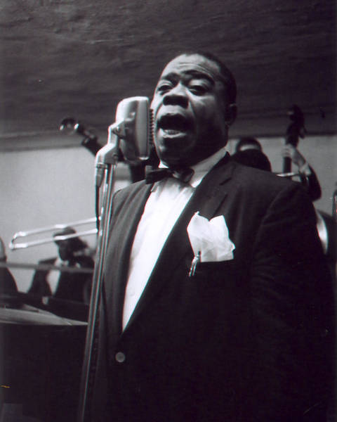African Daisies Photograph - Louis Armstrong Sings Into The Mic. by Retro Images Archive