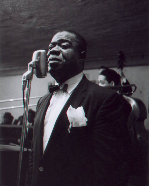 African Daisies Photograph - Louis Armstrong Stands In Front Of The Microphone by Retro Images Archive