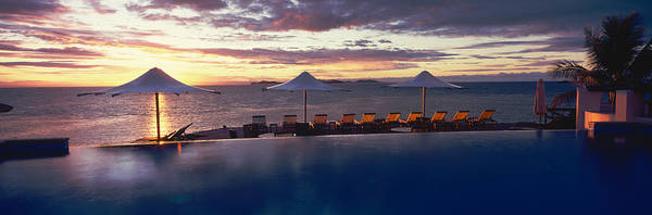 Peacefulness Photograph - Lounge Chairs And Patio Umbrellas by Panoramic Images