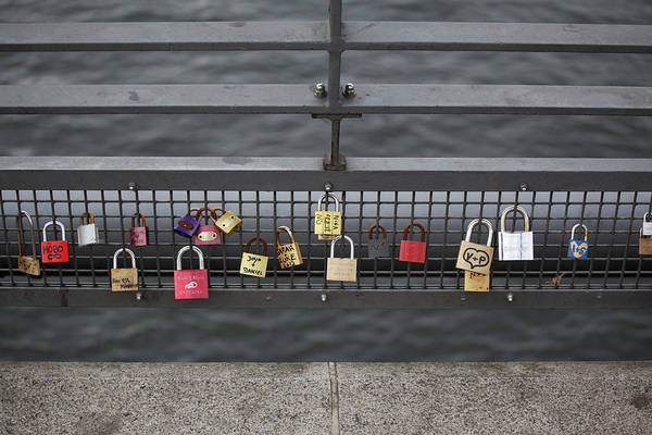 Hanging Photograph - Love Padlocks Hanging In A Row On A by Halfdark