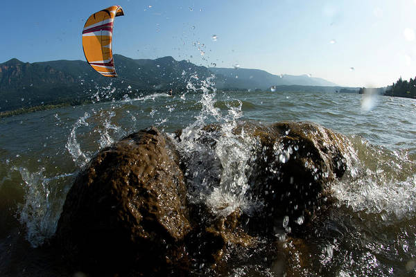 Wall Art - Photograph - Low Angle Perspective Of A Kiteboarder by Trevor Clark