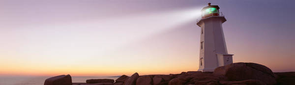 Peggys Cove Photograph - Low Angle View Of A Lighthouse At Dusk by Panoramic Images