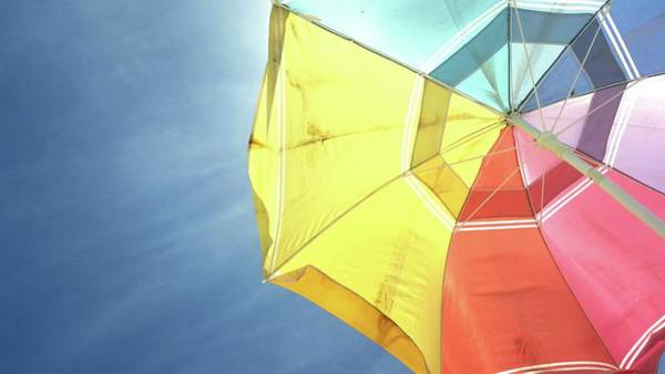 Parasol Photograph - Low Angle View Of Colorful Parasol by Taylor N / Eyeem