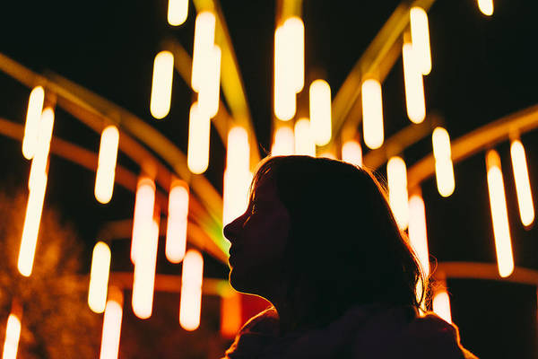 Low Angle View Of Silhouette Woman Against Illuminated Lights At Night Art Print by Adriana Duduleanu / EyeEm