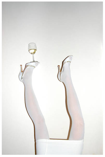 Upside Down Photograph - Low Section Of Woman Balancing Wine by Kostis Fokas / Eyeem