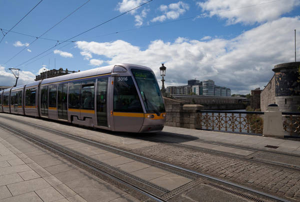River Liffey Wall Art - Photograph - Luas Tram On The Sean Heuston Bridge by Panoramic Images