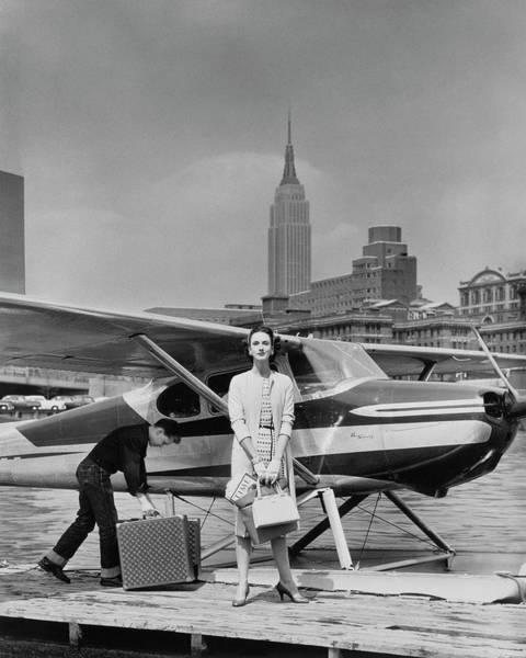 Two People Photograph - Lucille Cahart With Small Plane In Nyc by John Rawlings