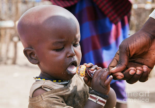 Western Costume Photograph - Maasai Child Trying To Eat A Lollipop In Tanzania by Michal Bednarek