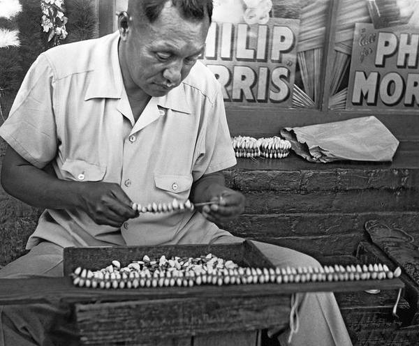 Wall Art - Photograph - Making Puka Shell Necklaces by Underwood Archives