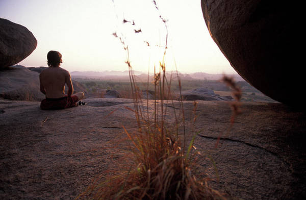 Wall Art - Photograph - Male Climber Meditating At Sunset by Corey Rich