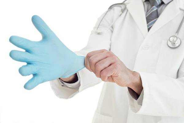 Wall Art - Photograph - Male Doctor Putting On Blue Latex Glove by Science Photo Library