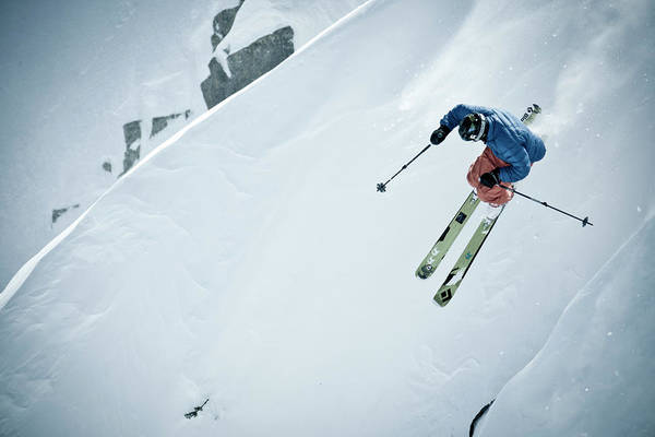 Ski Jumping Photograph - Male Skier Skiing Powder On A Sunny Day by Gabe Rogel