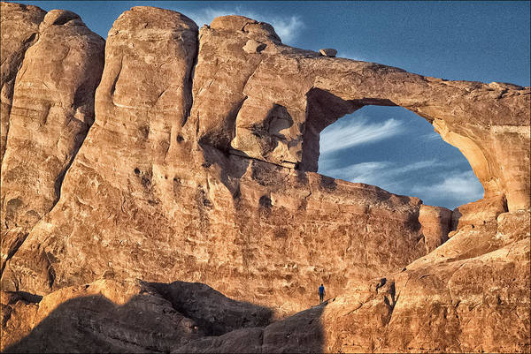 Moab Photograph - Man Against Rock by Robert Fawcett