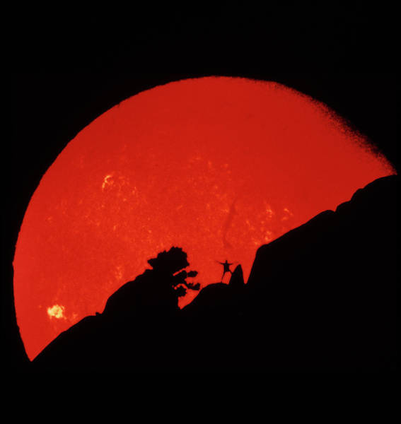 Wall Art - Photograph - Man Against Sun by Noaa/science Photo Library
