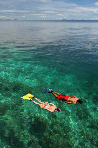 Snorkeling Photograph - Man And Woman Snorkelling by Keven Osborne/fox Fotos
