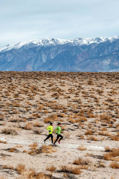 Knit Hat Photograph - Man And Woman  Trail Running by Rick Saez