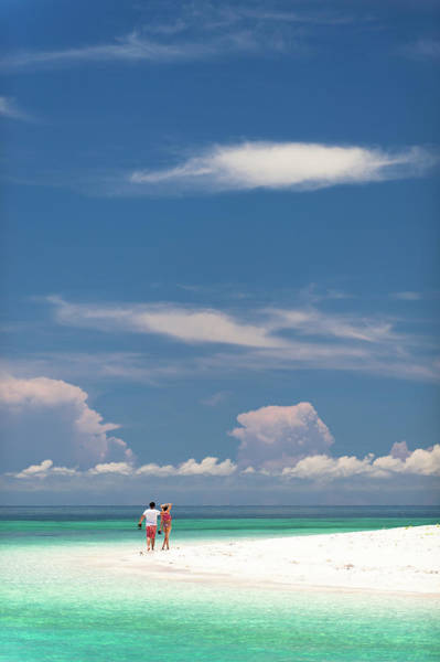 Casual Photograph - Man And Woman Walking Along Beach by Keven Osborne/fox Fotos