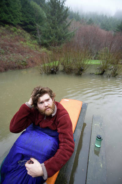 Awake Wall Art - Photograph - Man Asleep On Picnic Table In Flooded by Woods Wheatcroft