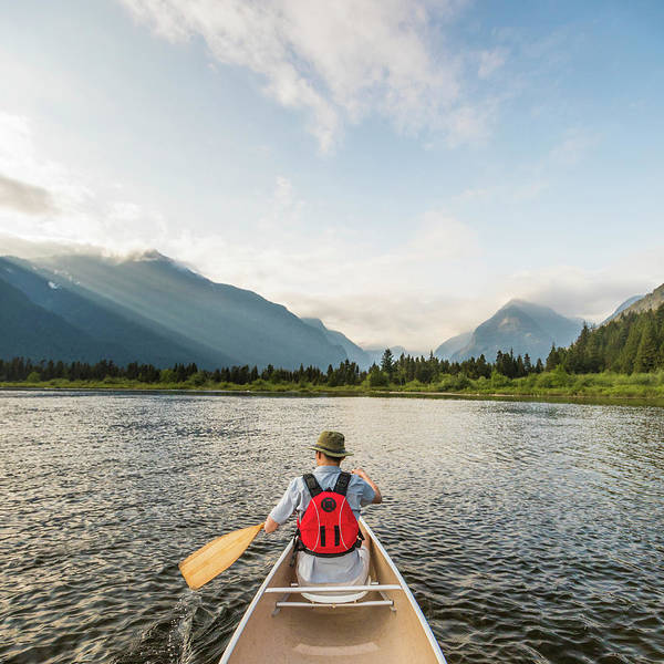 Metro Vancouver Wall Art - Photograph - Man Canoeing On Widgeon Creek In Front by Christopher Kimmel