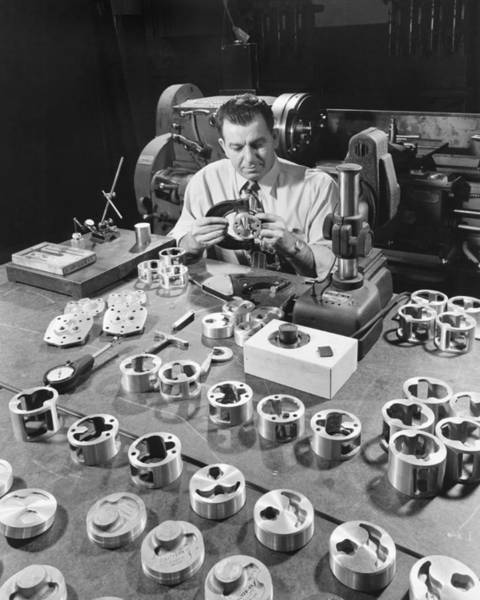 Checking Photograph - Man Checking Auto Parts by Underwood Archives