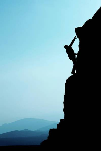 Wall Art - Photograph - Man Climbing Up Rocky Hillside by Ross Woodhall/science Photo Library