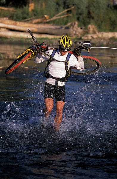 Ridgway Photograph - Man Crossing River With Mountain Bike by Corey Rich