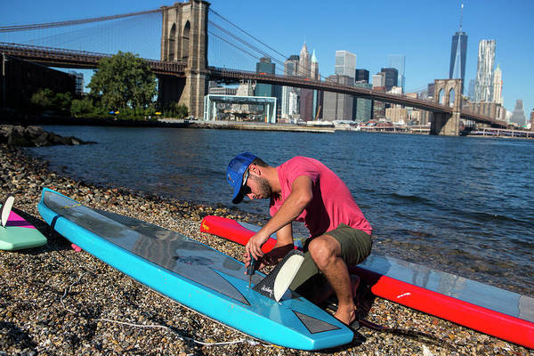 Standup Paddleboard Photograph - Man Crouching On Riverbank Preparing by Ryan Salm Photography