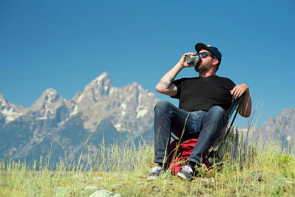 Wall Art - Photograph - Man Drinking Beer In Chair In Front by Rob Hammer