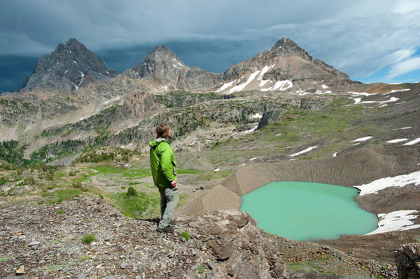 Glacial Photograph - Man Enjoys View Of Lake, Teton Crest by Howie Garber