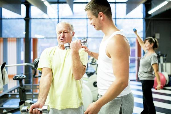 Senior Photograph - Man Exercising With Trainer by Science Photo Library