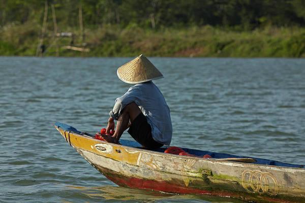 Hoi An Photograph - Man Fishing From Boat On Thu Bon River by David Wall