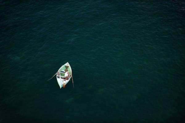 Fishing Boat Photograph - Man Fishing In Small Boat by Keven Osborne/fox Fotos
