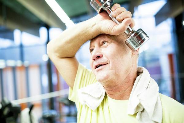 Self Confidence Photograph - Man Holding Dumbbell by Science Photo Library