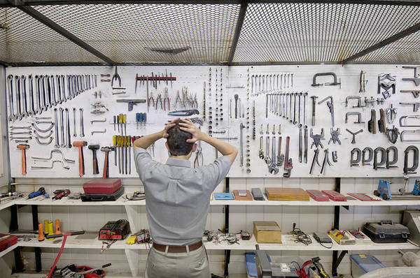 Man Holding Head By Wall Of Tools Art Print by Lester Lefkowitz