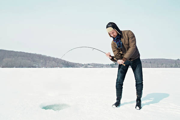 Adult Humor Photograph - Man Ice Fishing On Frozen Lake by Andy Ryan