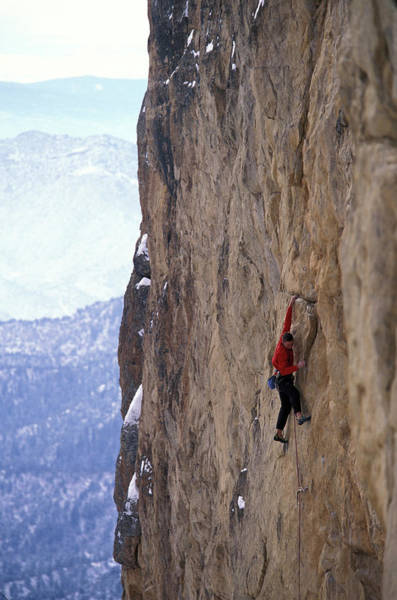 Elevation Photograph - Man In A Red Shirt Lead Climbing by Corey Rich