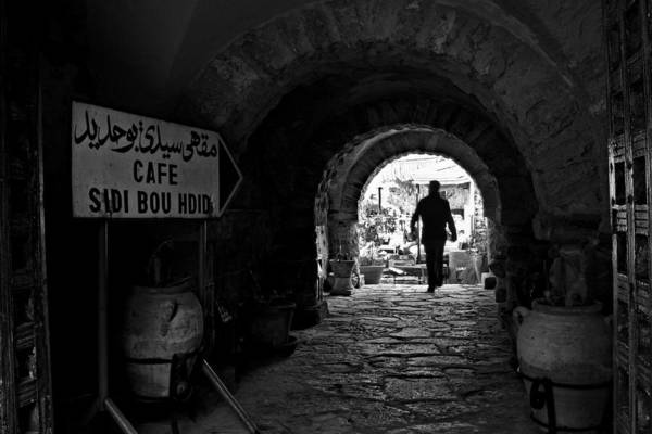 Photograph - Man In An Archway - Tunisia by Barry O Carroll