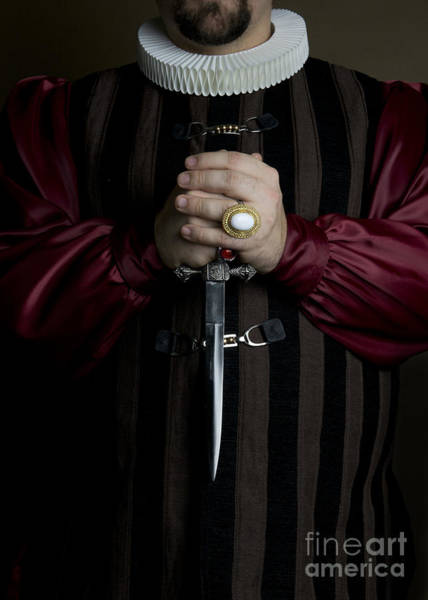 Photograph - Man In Baroque Outfits Holding A Silver Dagger by Jaroslaw Blaminsky