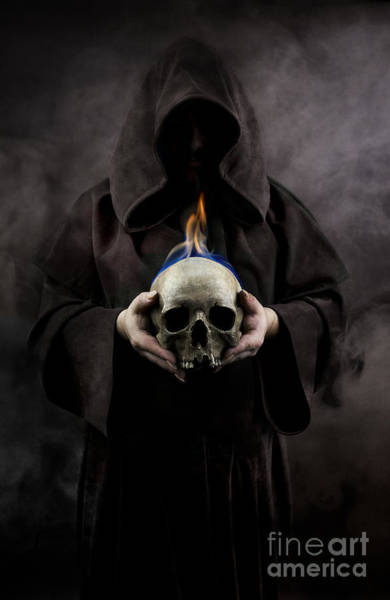 Photograph - Man In The Hooded Cloak Holding Burning Human Skull In His Hand by Jaroslaw Blaminsky