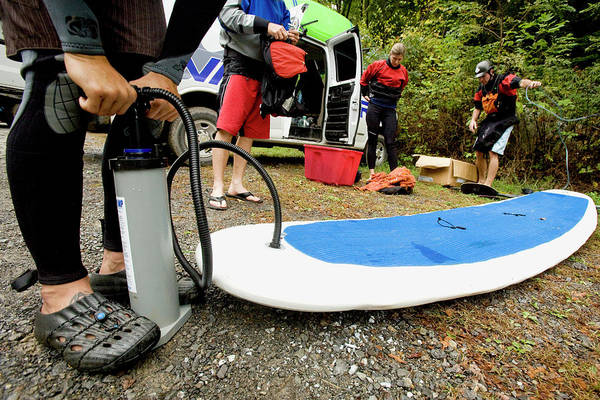 Fayetteville Photograph - Man Inflating A Stand Up Paddleboard by Trevor Clark